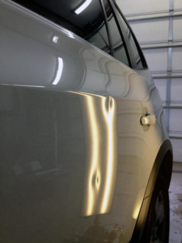BMW X3 door dents Plymouth, MN Dent Werks PDR